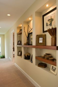 A unique built-in makes great use of the upstairs hallway in the 2011 Showcase of Homes model in Harvest Bend. Interior design by Plum & Crimson. Home Living Room, Living Room Decor, Recessed Shelves, Wall Shelving, Niche Design, Hallway Designs, Hallway Ideas, Built In Bookcase, Home Interior Design