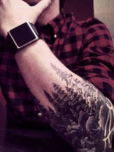 pine evergreen forest trees with reversed out fence -I dont know why but Im really drawn to these guys tattoos with a forest theme on forearm