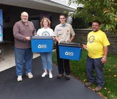 Sean Pittack, Eagle Scout candidate, presents cardboard/paper recycling containers to Mayfield Borough representatives. From Left: Don Mosley and Janice Joyce, Council members; Sean Pittack; and Paul Natishak, Superintendent, Mayfield Borough Public Works.