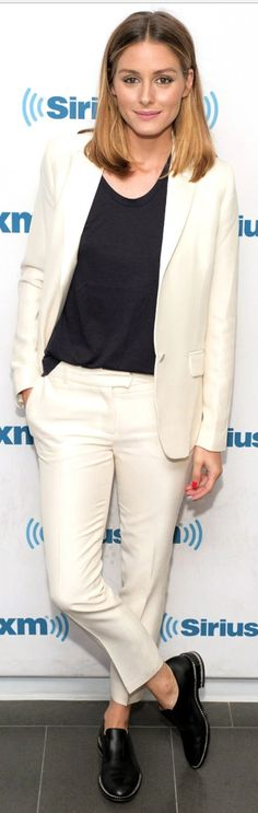 Who made Olivia Palermo's white pants, blazer, and chain black shoes?