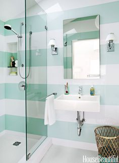 "Designer Angela Free installed tiles to form wide, horizontal stripes in a 37-square-foot guest bathroom in a San Francisco, California house. ""Stripes are a nice, graphic design element that can bring movement and pattern to a room, but not in a busy way,"" she says. By wrapping the pattern around the space, she opened it up and created ""flow, a borderless space.""   - HouseBeautiful.com"