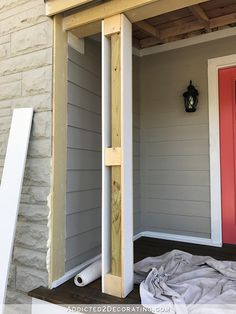 How To Wrap Front Porch Posts (Turn Skimpy Front Porch Posts Into Pretty Columns) – Part 1 – Addicted 2 Decorating® – farmhouse front door with screen House With Porch, House Exterior, Front Porch Posts, Porch Design, Porch Makeover, Porch Flooring, Concrete Porch, Porch Kits, Building A Porch