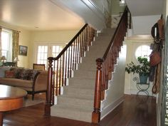 Opening up side of stairway how to transition from for Center hall colonial living room ideas