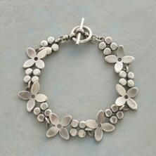 This sterling silver flower bracelet brings a simple loveliness and lustre to your look.
