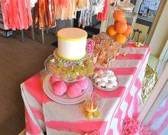 love the neon table cloth and tassel garland