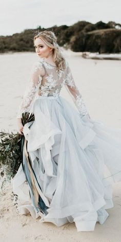 wedding dress blue 21 Adorable Blue Wedding Dresses For Romantic Celebration blue wedding dresses ball gown with long sleeves lace ruffled skirt goddessbynature Blue Wedding Gowns, White Bridal Dresses, Stunning Wedding Dresses, Blue Bridal, Princess Wedding Dresses, Bridal Outfits, Wedding Dress Styles, Beautiful Gowns, Bridal Gowns