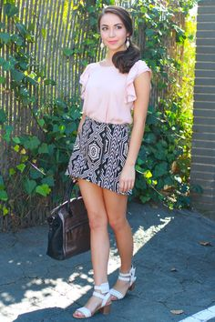 Sweet, pale pink chiffon blouse with a cascade of ruffled sleeves.