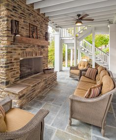 This is the lower floor to a two story porch. The lower story is open air while the upper story is screened in, both boasting a beautiful fireplace.
