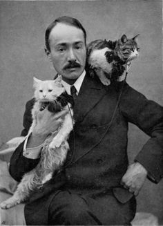 "rnold Henry Savage Landor with cats Kerman and Zeris, whom he travelled with in ""Across Coveted Lands""   Note they have leashes."