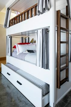The bunk bed features a trundle. Bedding is from Pine Cone Hill.