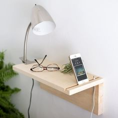 This floating nightstand is a great space-saver and includes a spot for your phone and charger!