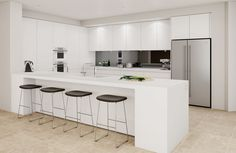 White handle-less kitchen with black splashback and white Smeg Linea appliances.