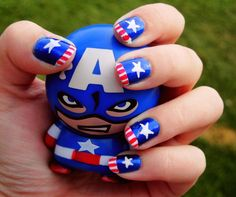 captain america nails; stars and stripes on one nail; solid color of white, red, or blue on the rest