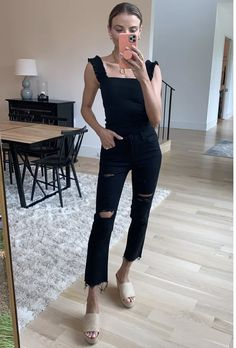 Black tank with ruffle sleeves and black wide legged jeans paired with tan platform sandals.