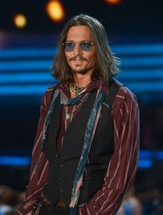ALL the Grammys Red Carpet, Show, and Party Pictures in One Place!: Johnny Depp took the stage to introduce performers Mumford & Sons at the 2013 Grammy Awards.   : Johnny Depp sported shades during the Grammy Awards.
