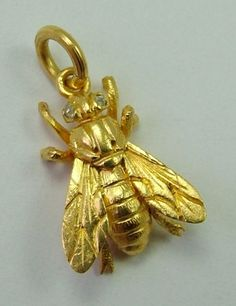 A 1920s solid 18ct gold honey bee charm with old cut diamond eyes.