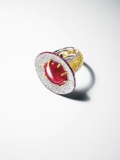 Martin Katz | 18-karat white and yellow gold ring with a 10.17-carat cabochon ruby set with white and yellow diamonds and rubies.
