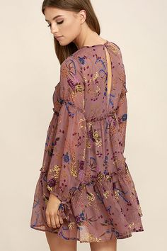 Let the Secret Place Mauve Floral Print Dress take you away to a magical place filled with delight! Purple, yellow, blue, and green floral print embellishes mauve woven poly as it falls from a rounded neckline into a babydoll bodice accented with pleated detail and ruffled tiers. Long sleeves have tying cuffs. Back keyhole with top button closure.