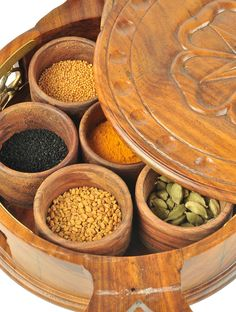 Masala Dabba   The ubiquitious everyday spice container imbued with a sense of rare beauty and elegance. Hand-crafted in the finest wood and bronze by a Jaipur master craftsman, the Masala Dani may just have you spending more time in the kitchen, admiring its beauty and uncovering the magic of the spices it will so delicately house!