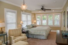 Large Downstairs Master Bedroom with lots of windows and a pretty view of the private back pati