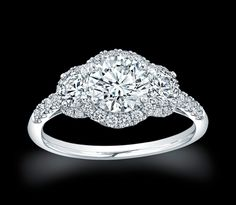 Three Stone Halo Ring Settings   The Spiral Halo : This stunning Hearts on Fire engagement ring is ...