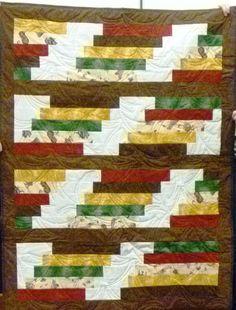 Love this modern strip quilt, made by Arzi Shinn.