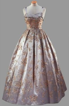 "Formal Gown, Hardy Amies: 1957, satin embroidered with bugle and beads and crystals. ""Worn [by HRH Queen Elizabeth II] during the State Visit to America, for a State Banquet at the White House given by President Eisenhower, October 1957."""