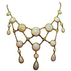 1895  Victorian Opal Necklace made in 14K Yellow Gold, 20 Opals, and 40 old European cut Diamonds