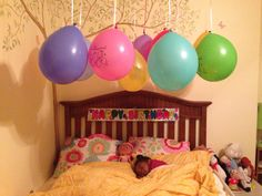 Birthday morning surprise for my soon to be 4 year old. Balloons and banner from Dollar Tree and from the 99cents store.