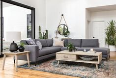 Alistair 4-Piece Sectional. This grey sectional sofa offers sleek styling, padded arm interiors, satin black-finished metal legs and neatly tailored cushions. High-quality construction is on par with the high-end look, so you can enjoy a refined yet relaxing experience. See more styles from #WestsideLoft #LivingSpaces