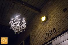Crystal chandelier hung out side Gallery 1028. #studioag #studioagdesign Photo by Cage and Aquarium http://cageandaquarium.com/home/index.php