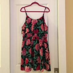 Floral spaghetti strap dress Bold floral spaghetti strap dress with a comfortable and flattering elastic waist. Very stretchy! Worn once on vacation, and in excellent condition. Elle Dresses Midi