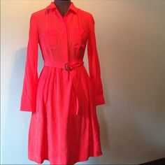 J Crew shirt dress Beautiful bright coral shirt dress. Front pockets and button up top. Removable belt. 100% silk. 37 Inches from shoulder to bottom. No trades J. Crew Dresses Long Sleeve