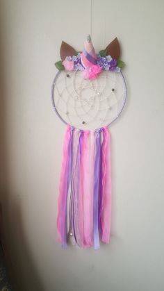 Unicorn dreamcatcher made by me. First one I've made like this pretty happy with the outcome x