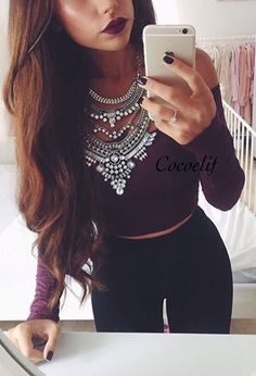 Cute outfit. Maroon cropped top. Highwaisted black jeans. Statement necklace. Cute outfit.