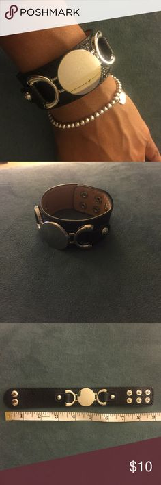 Leather Cuff Bangle Trendy cuff bangle with adjustable snaps.             Metal color: silver                                                        Color: Black                                                                  Material: faux leather *Check out my closet for other colors Jewelry Bracelets