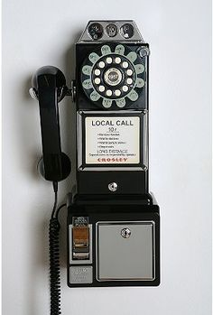 We had one of these 1950 telephones in our home during the 50s and 60s. Daddy had it rigged to use with money.  With 4 daughters, he reaped something in return with all of the outgoing phone calls we made.  Mom still has it in her new house.