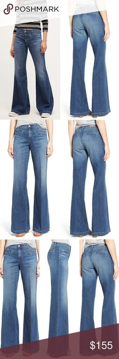 """AG Lana Wide Leg Bell Bottom Trouser Jeans Boho 28 Anthropologie AG Adriano Goldschmied Lana Wide Leg High Rise Bell Bottom Trouser Jeans SOLD OUT! Flared 70's Inspired soft stretch Blogger Favorite Capsule Wear to Work Party Everyday Casual Bohemian Boho Denim Festival Kendall Jenner Must! Retails: $225 Size: 28 Waist: 14.75"""" Hips:m18"""" Rise: 9.75"""" Length: 43.75"""" Inseam: 34"""" Condition: NWT Item on Model is for style reference only. Flat item for sale & will be shipped. Measurements are…"""