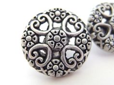 Vintage silvertone metal, filigree buttons have heart and flowers design. There is a molded shank on back of the pewter - look buttons to attach it