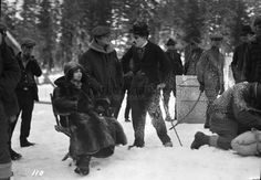 Mr. Chaplin and Miss grey with others on the set of The Gold Rush