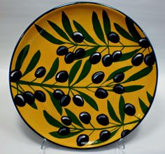 Olive plate, old pattern painted by artist Geoff Graham of CInnabar Ceramics in Vallejo, California.