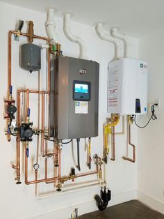 NTI High Efficiency Propane Boiler, for in floor radiant heat. Grundfos Alpha Circ Pump, Copper Piping for distribution system.
