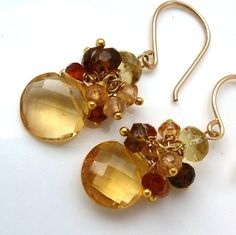 """Beautiful Soft Honey Amber colored Citrine Coin briolettes dangle from a wire wrapped cluster of Hessonite Garnet with a Lemon Quartz capstone on Gold Filled wire and hook. Beautiful soft colors will go with anything day or night!   +Citrine is November Birthday Stone+    Total earring length is between 1 1/3 and 1 1/2 inches, citrine coin bead is about 1/3"""""""