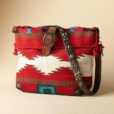 Sundance cross body bag. Looks like it's made from a horse blanket and an old belt...so crafty!