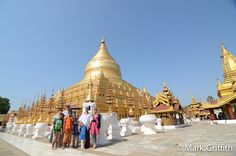 https://flic.kr/p/bkSBFT | Shwezigon Pagoda | The classic tourist pose out front of the gilded Zedi of the Shwezigon Pagoda. ---- Photo from the Bagan portion of our trip to Myanmar.