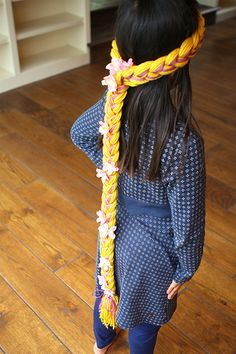 rapunzel wig for less than $5 I made these - For the little girls that came to the party - Very easy and they turned out really cute.