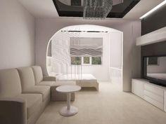Белая гостиная-спальня с диваном и кроватью