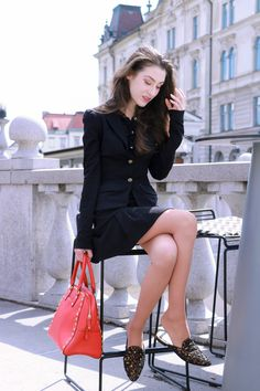 Fashion blogger Veronika Lipar of Brunette From Wall Street sharing fashionable business casual outfit in black short skirt suit and flats