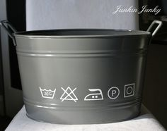 "Super cute laundry bucket from Junkin' Junky. Would be cute on the shelf with most used laundry products in it. Not sure if I like the laundry symbols or the word ""laundry"" better."