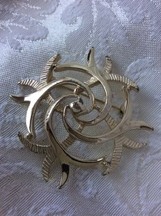 A personal favorite from my Etsy shop https://www.etsy.com/listing/233892316/golden-sarah-swirl-signed-brooch